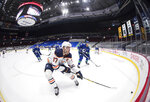 Edmonton Oilers' Connor McDavid (97) skates after the puck while being watched by Vancouver Canucks' Alexander Edler (23), of Sweden, during the first period of an NHL hockey game, Monday, May 3, 2021, in Vancouver, British Columbia. (Darryl Dyck/The Canadian Press via AP)