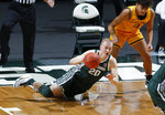 Michigan State's Joey Hauser, left, drives for a loose ball against Oakland's Trey Townsend during the first half of an NCAA college basketball game, Sunday, Dec. 13, 2020, in East Lansing, Mich. (AP Photo/Al Goldis)
