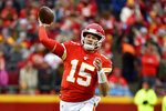 Kansas City Chiefs quarterback Patrick Mahomes (15) throws a pass during the first half of an NFL football game against the Oakland Raiders in Kansas City, Mo., Sunday, Dec. 1, 2019. (AP Photo/Ed Zurga)