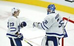Toronto Maple Leafs goaltender Frederik Andersen (31) celebrates a win over the Arizona Coyotes with Maple Leafs defenseman Travis Dermott (23) as time runs out in third period of an NHL hockey game Thursday, Nov. 21, 2019, in Glendale, Ariz. (AP Photo/Ross D. Franklin)