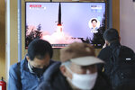 A TV screen shows a file image of North Korea's missile launch during a news program at the Seoul Railway Station in Seoul, South Korea, Sunday, March 29, 2020. North Korea on Sunday fired two suspected ballistic missiles into the sea, South Korea said, calling it