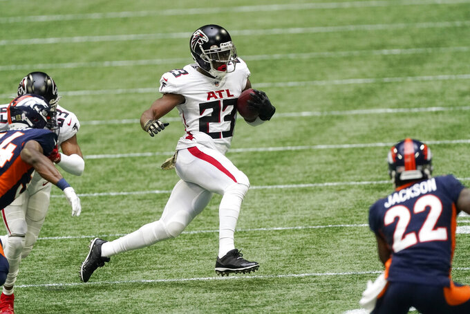 Atlanta Falcons running back Brian Hill (23) runs against the Denver Broncos during the first half of an NFL football game, Sunday, Nov. 8, 2020, in Atlanta. (AP Photo/John Bazemore)