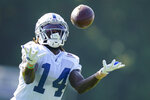 Indianapolis Colts wide receiver Zach Pascal (14) tries to make a catch during practice at the NFL team's football training camp in Westfield, Ind., Tuesday, Aug. 24, 2021. (AP Photo/Michael Conroy)