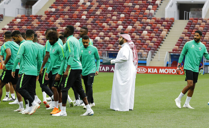 FILE - In this June 13, 2018 file photo, Saudi Arabia's sports minister Turki Alsheikh talks to the national soccer team players at the 2018 soccer World Cup at Luzhniki stadium in Moscow, Russia. Egypt's close relations with Saudi Arabia are being tested by a soccer spat sparked by an uproar over meddling by Alsheikh. The minister's attempts over the last year to exert control of Egypt's biggest team enraged fans, officials and one of the country's greatest players. The acrimonious fallout led to the confidant of Saudi Arabia's powerful crown prince buying a rival club in a bid to challenge Al-Ahly's supremacy. (AP Photo/Antonio Calanni, File)