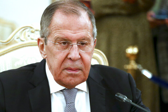Russian Foreign Minister Sergey Lavrov listens to Iceland's Minister for Foreign Affairs Gudlaugur Thor Thordarson during their meeting in Moscow, Russia, Tuesday, Nov. 26, 2019. Lavrov cast the WADA's compliance review committee's proposal of a four-year ban on hosting major events in Russia and a ban for the same period on flying the Russian flag at major competitions as part of Western efforts to sideline Russia by accusing it of misconduct in various spheres. (Russian Foreign Ministry Press Service via AP)