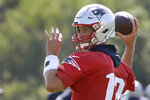 New England Patriots quarterback Tom Brady winds up to pass the ball during an NFL football training camp practice, Thursday, July 25, 2019, in Foxborough, Mass. (AP Photo/Steven Senne)