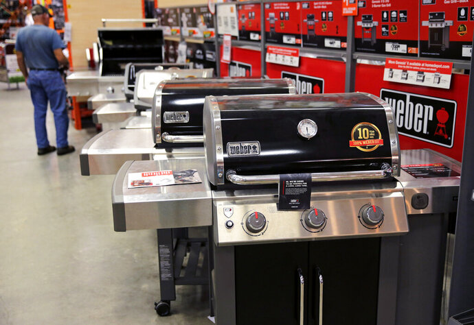 FILE - In this July 11, 2019, file photo Weber grills are displayed at the Home Depot store in Londonderry, N.H. The Home Depot Inc. on Tuesday, Aug. 20, reported fiscal second-quarter net income of $3.48 billion.  (AP Photo/Charles Krupa, File)