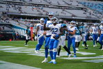Detroit Lions running back D'Andre Swift (32) celebrating a touchdown during a NFL football game against the Jacksonville Jaguars on Sunday, Oct. 18, 2020 in Jacksonville, FL. The Lions defeated the Jaguars 34-16 (Detroit Lions via AP).