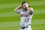 Houston Astros second baseman Jose Altuve wipes his forehead during a pause in the fifth inning of a baseball game against the Seattle Mariners, Wednesday, Sept. 23, 2020, in Seattle. (AP Photo/Ted S. Warren)