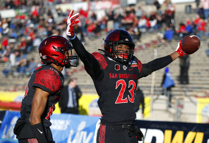 San Diego State cornerback Darren Hall (23) celebrates with teammate Luq Barcoo after scoring a touchdown on a Central Michigan fumble return during the second half of the New Mexico Bowl NCAA college football game on Saturday, Dec. 21, 2019 in Albuquerque, N.M. (AP Photo/Andres Leighton)