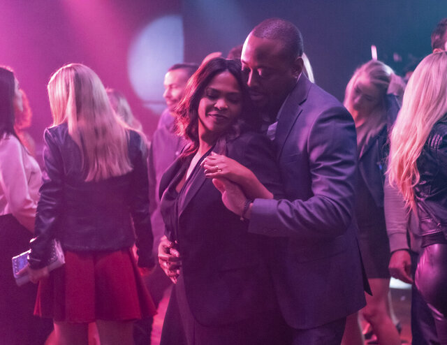This image released by Netflix shows Nia Long, left, and Omar Epps in a scene from