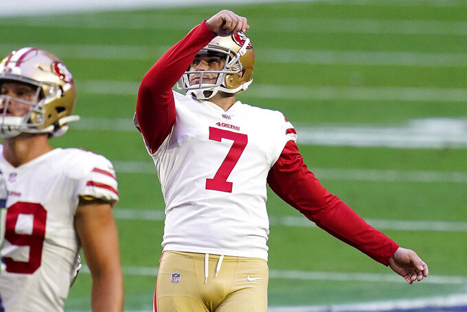 San Francisco 49ers kicker Tristan Vizcaino (7) watches his field goal split the uprights during the first half of an NFL football game against the Seattle Seahawks, Sunday, Jan. 3, 2021, in Glendale, Ariz. (AP Photo/Ross D. Franklin)