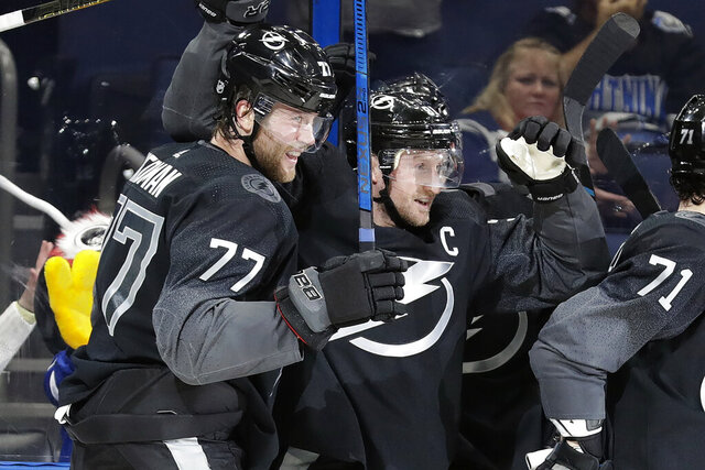 Tampa Bay Lightning center Steven Stamkos (91) celebrates his goal against the Montreal Canadiens with defenseman Victor Hedman (77) during the second period of an NHL hockey game Saturday, Dec. 28, 2019, in Tampa, Fla. (AP Photo/Chris O'Meara)