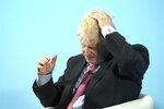 Conservative Party leadership candidate Boris Johnson gestures, during a Conservative leadership hustings in Maidstone, England, Thursday July 11, 2019. (Gareth Fuller/PA via AP)