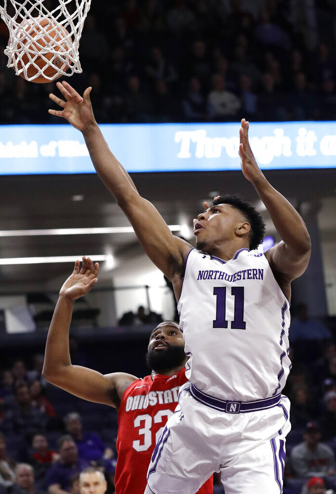 Northwestern guard Anthony Gaines, right, shoots against Ohio State guard Keyshawn Woods during the second half of an NCAA college basketball game Wednesday, March 6, 2019, in Evanston, Ill. (AP Photo/Nam Y. Huh)