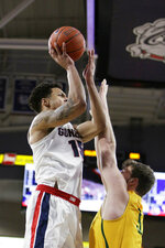 Gonzaga forward Brandon Clarke, left, shoots over San Francisco center Jimbo Lull during the first half of an NCAA college basketball game in Spokane, Wash., Thursday, Feb. 7, 2019. (AP Photo/Young Kwak)