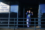 "Dr. Alan Roth walks to his office after an interview at Jamaica Hospital Medical Center in New York, Tuesday, Dec. 29, 2020. Dozens of clinics have cropped up around the U.S. to address a puzzling and troubling aspect of COVID-19 — the after-effects that can stubbornly afflict some people weeks or months after the infection itself has subsided. ""We know this is real,"" said Roth, who oversees the Jamaica Hospital clinic. He has been grappling with body pain, fatigue and ""brain fog"" characterized by occasional forgetfulness since his own relatively mild bout with COVID-19 in March. (AP Photo/Seth Wenig)"