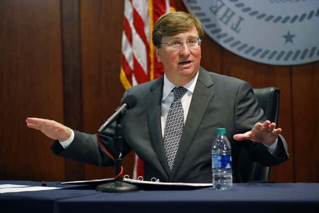 Mississippi Gov. Tate Reeves responds to a reporter's question regarding the possibility of facing a lawsuit that challenged his partial veto of a bill spending COVID-19 relief funds during his coronavirus press briefing, in Jackson, Miss., Wednesday, Aug. 5, 2020. (AP Photo/Rogelio V. Solis)