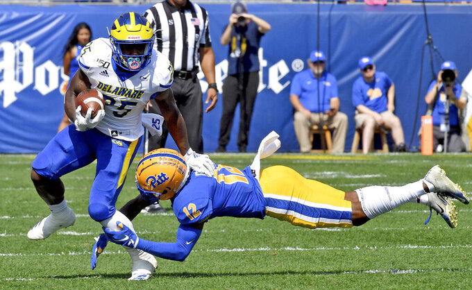 Delaware running back Will Knight carries as he's defended by Pitt defensive back Paris Ford in the first quarter of an NCAA college football game Saturday, Sept. 28 2019, at Heinz Field in Pittsburgh. (Matt Freed/Pittsburgh Post-Gazette via AP)