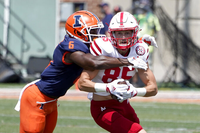 Illinois defensive back Tony Adams tackles Nebraska wide receiver Wyatt Liewer during the first half of an NCAA college football game Saturday, Aug. 28, 2021, in Champaign , Ill. (AP Photo/Charles Rex Arbogast)