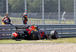 Red Bull driver Alexander Albon of Thailand, right, stands by car after he crashed into the track wall during the second practice session for the British Formula One Grand Prix at the Silverstone racetrack, Silverstone, England, Friday, July 31, 2020. The British Formula One Grand Prix will be held on Sunday. (Andrew Boyers/Poolvia AP)