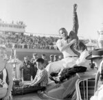 FILE - In this Feb. 26, 1961, file photo, Marvin Panch, Daytona Beach winner of the 500-mile late model stock car race, waves to the crowd as he sits on top of his car with his two kids, Marvin, left, and Lynn, in Daytona Beach Fla. Panch, a former Daytona 500 winner, was nominated for induction into the NASCAR Hall of Fame on Wednesday, March 13, 2019.  (AP Photo/File)