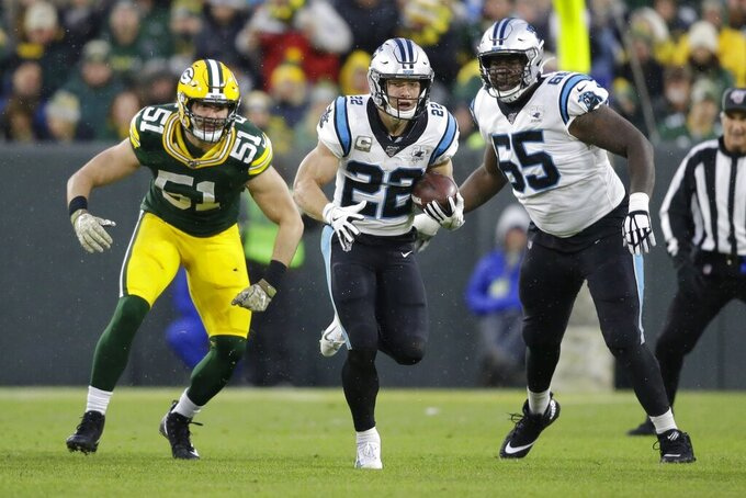 Carolina Panthers' Christian McCaffrey runs during the first half of an NFL football game against the Green Bay Packers Sunday, Nov. 10, 2019, in Green Bay, Wis. (AP Photo/Jeffrey Phelps)