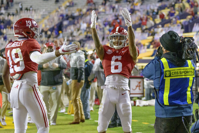 Alabama wide receiver DeVonta Smith (6) blows kisses to the stands after a touchdown during the first half of an NCAA college football game against LSU in Baton Rouge, La., Saturday, Dec. 5, 2020. (AP Photo/Matthew Hinton)