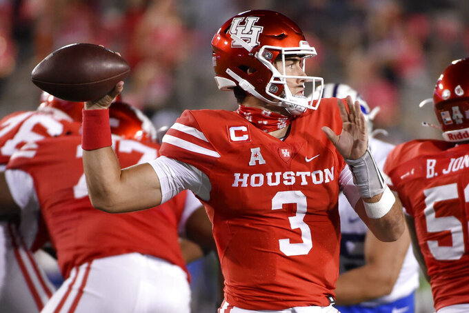 Houston quarterback Clayton Tune (3) throws a pass during the second half of an NCAA college football game against BYU, Friday, Oct. 16, 2020, in Houston. (AP Photo/Eric Christian Smith)