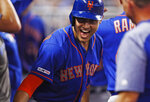 New York Mets' Michael Conforto celebrates in the dugout after a two-run home run during the third inning of a baseball game against the Miami Marlins, Saturday, July 13, 2019, in Miami. (AP Photo/Brynn Anderson)