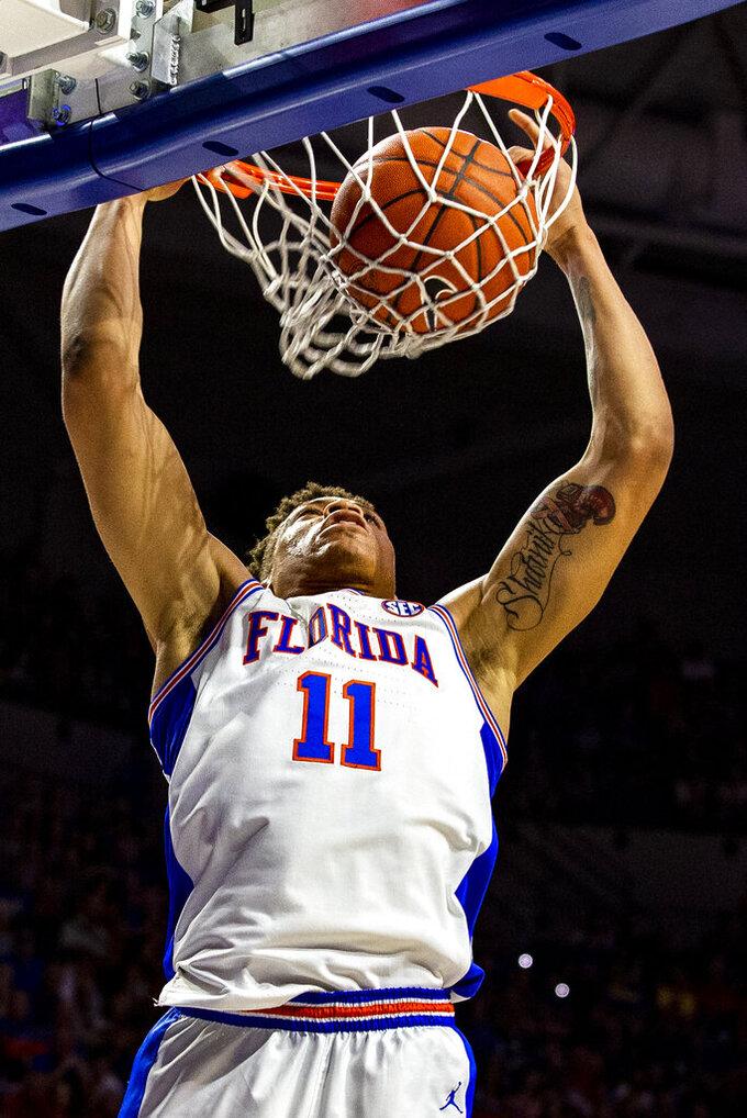 Florida forward Keyontae Johnson (11) dunks during an NCAA college basketball game against Missouri, Saturday, Feb. 23, 2019. (Lauren Bacho/The Gainesville Sun via AP)