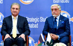 Abdullah Abdullah, right, chairman of Afghanistan's High Council for National Reconciliation, and Pakistani Foreign Minister Shah Mahmood Qureshi, attend an event in Institute of Strategic Studies, in Islamabad, Pakistan, Tuesday, Sept. 29, 2020. The chief of Afghanistan's peace negotiating team said Tuesday on a visit to Pakistan that the time has come for the two neighboring countries to shun the suspicion,