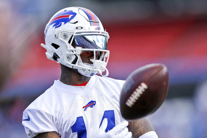 FILE - In this July 31, 2021, file photo, Buffalo Bills wide receiver Stefon Diggs tosses a ball during NFL football practice in Orchard Park, N.Y. For all the individual feats Diggs accomplished in his first season in Buffalo, the receiver is most proud of the vote of confidence he earned from his teammates in being named a captain entering this year. (AP Photo/Joshua Bessex, File)