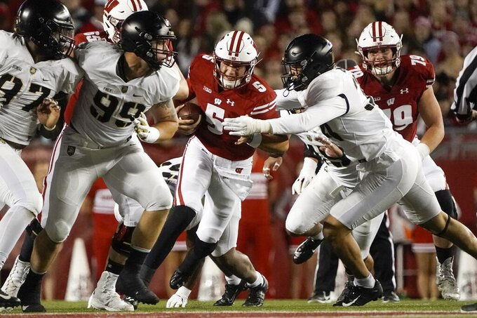 Wisconsin's Graham Mertz runs during the first half of an NCAA college football game against Army Saturday, Oct. 16, 2021, in Madison, Wis. (AP Photo/Morry Gash)