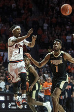 Illinois' Trent Frazier (1) passes the ball past Purdue defender Aaron Wheeler (1) in the first half of an NCAA college basketball game, Sunday, Jan. 5, 2020, in Champaign, Ill. (AP Photo/Holly Hart)