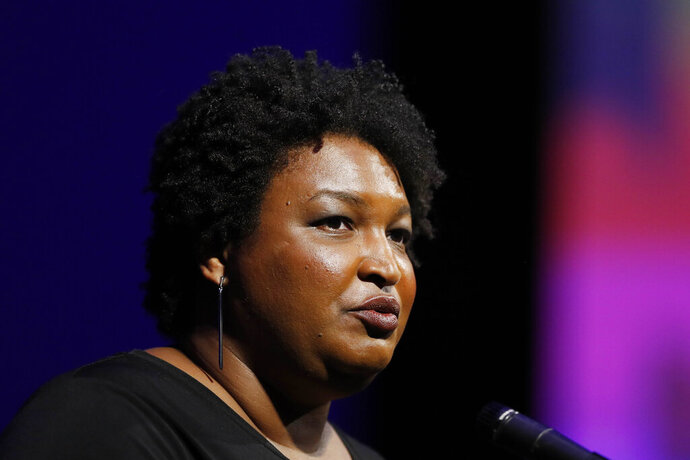 File- This July 22, 2019, file photo shows former Georgia House Minority Leader Stacey Abrams addressing the 110th NAACP National Convention,  in Detroit. Abrams is set to announce a multimillion-dollar initiative to staff and fund voter protection teams in battleground states across the country ahead of the 2020 elections. An aide familiar with the decision said she'll focus on the new program rather than run for president herself. The aide said Abrams would announce the initiative Tuesday, Aug. 13, 2019, during a speech before a labor union convention in Las Vegas. (AP Photo/Carlos Osorio, File)