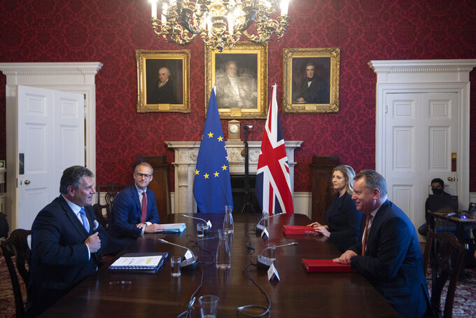 """Britain's Minister for the Cabinet Office of the United Kingdom, David Frost, right, speaks to his EU counterpart Maros Sefcovic, during a meeting, in London, Wednesday, June 9, 2021. The U.K. has called upon the European Union to show pragmatism and """"common sense,"""" as the two sides meet to resolve differences over the deal that was supposed to keep trade flowing in Northern Ireland after Brexit. (Eddie Mulholland/Pool Photo via AP)"""