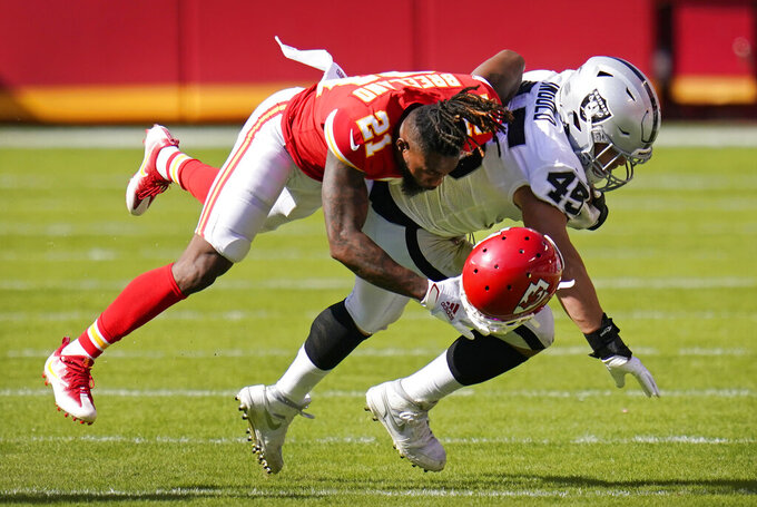 Kansas City Chiefs cornerback Bashaud Breeland (21) loses his helmet as he tackles Las Vegas Raiders fullback Alec Ingold (45) during the second half of an NFL football game, Sunday, Oct. 11, 2020, in Kansas City. (AP Photo/Jeff Roberson)