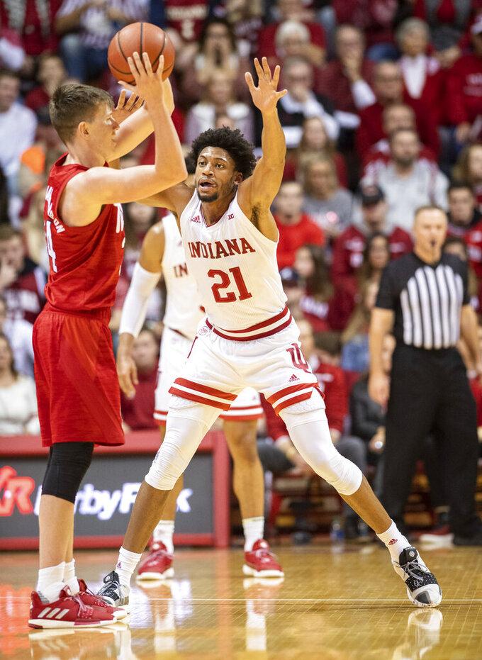 Indiana forward Jerome Hunter (21) guards against Nebraska guard Thorir Thorbjarnarson (34) during the first half of an NCAA college basketball game, Friday, Dec. 13, 2019, in Bloomington, Ind. (AP Photo/Doug McSchooler)