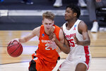 Syracuse forward Marek Dolezaj (21) drives on Houston forward Brison Gresham (55) in the second half of a Sweet 16 game in the NCAA men's college basketball tournament at Hinkle Fieldhouse in Indianapolis, Saturday, March 27, 2021. (AP Photo/Michael Conroy)