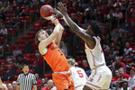 Oregon State forward Tres Tinkle, front left,tries to shoot over Utah forward Donnie Tillman, right, during the first half of an NCAA college basketball game, Saturday, Feb. 2, 2019, in Salt Lake City. (AP Photo/Chris Nicoll)