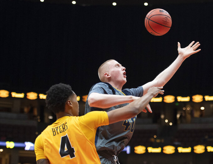 UC Irvine forward Collin Welp, right, is fouled by Long Beach State forward KJ Byers during the first half of an NCAA college basketball game at the Big West men's tournament in Anaheim, Calif., Friday, March 15, 2019. (AP Photo/Kyusung Gong)