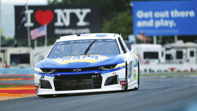 "Chase Elliott (9) drives through the area of the course called ""The Bus Stop"" during a practice run for the NASCAR Cup Series auto race at Watkins Glen International, Saturday, Aug. 3, 2019, in Watkins Glen, New York. (AP Photo/John Munson)"