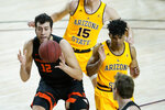 Oregon State center Roman Silva (12) is fouled by Arizona State guard Remy Martin as forward John Olmsted (15) looks on during the first half of an NCAA college basketball game, Sunday, Feb. 14, 2021, in Tempe, Ariz.(AP Photo/Matt York)