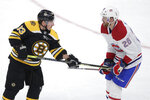 Boston Bruins left wing Brad Marchand (63) pokes Montreal Canadiens defenseman Jeff Petry (26) during the first period of an NHL hockey game in Boston, Wednesday, Feb. 12, 2020. (AP Photo/Charles Krupa)