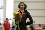 FILE— In this Feb. 23, 2019, file photo, Vashti Cunningham poses for photographers after winning the women's high jump final at the USA Track & Field Indoor Championships in New York. Cunningham is one of the athletes who will be competing in the American Track League, which opens a four-week-long series on Sunday, Jan. 24, 2021 in an indoor setting at the University of Arkansas. (AP Photo/Julio Cortez. File)