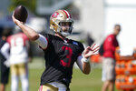 San Francisco 49ers quarterback Josh Rosen throws a pass at NFL football training camp in Santa Clara, Calif., Tuesday, Aug. 10, 2021. (AP Photo/Jeff Chiu)