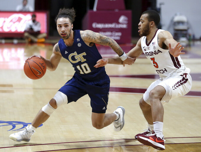 Georgia Tech's Jose Alvarado (10) drives past Virginia Tech's Wabissa Bede (3) during the second half of an NCAA college basketball game Tuesday, Feb. 23, 2021, in Blacksburg, Va. (Matt Gentry/The Roanoke Times via AP, Pool)