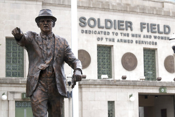 The newly dedicated statue of Chicago Bears founder George S. Halas stands outside Soldier Field during an unveiling ceremony of statues honoring Halas and Walter Payton Tuesday, Sept. 3, 2019, in Chicago. (AP Photo/Charles Rex Arbogast)