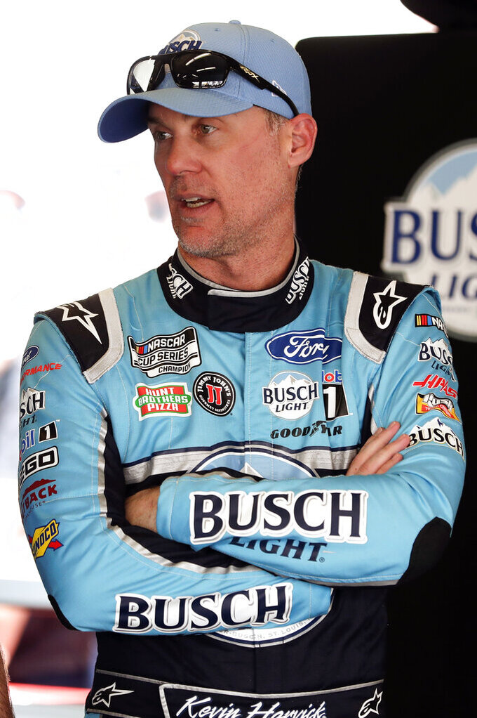 Kevin Harvick talks with crew members in his garage after a practice session for the NASCAR Daytona 500 auto race at Daytona International Speedway, Saturday, Feb. 15, 2020, in Daytona Beach, Fla. (AP Photo/John Raoux)